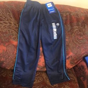 BRAND New kid's champion sweat pants in navy blue